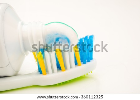 A toothbrush with toothpaste on isolated - stock photo