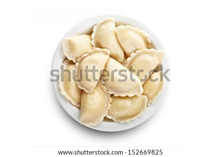 A top-down view on ravioli on the plate - stock photo