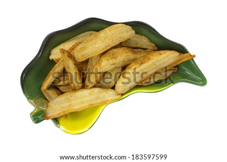 A top view of a dish of fresh baked frozen potato wedges on a white background. - stock photo