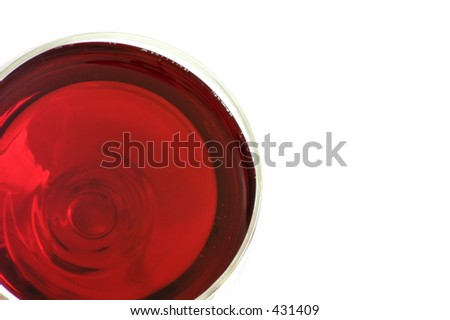 A top view of a glass of red wine, air bubbles in the wine are also visible,with blank space for further editing by designers