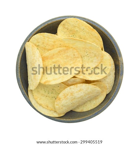 A top view of a gray ceramic bowl filled with generic sour cream and onion potato chips. - stock photo