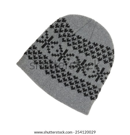 A top view of a gray winter knit cap with a black design. - stock photo