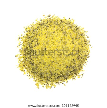 A top view of a mound of lemon pepper seasoning on a white background. - stock photo