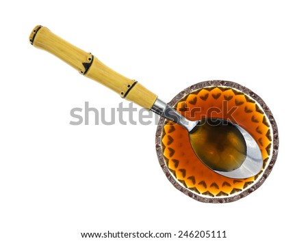 A top view of a small decorative bowl of clear Au Jus Gravy with spoon. - stock photo