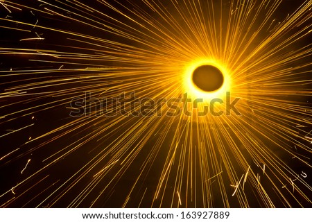 A top view of a type of firework/cracker known as Chakra or Chakri rotating on the ground, during the Diwali festival celebrations in India  - stock photo