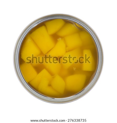 A top view of an opened can of mangos on a white background. - stock photo