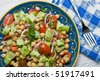 A top view of chickpea (garbanzo bean) salad on a colorful plate - stock photo