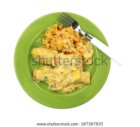 A top view of enchiladas and seasoned rice on a green plate with fork.