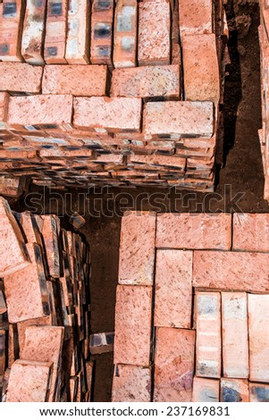 A top view of stacked bricks, ready for the builder to use on completing the new house. - stock photo