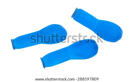 A top view of three blue water balloons on a white background. - stock photo