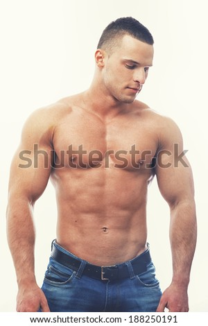 A topless masculine man in jeans - stock photo