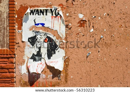 """A torn poster of Uncle Sam, """"I Want You"""" - makes an ironic statement about the government. - stock photo"""