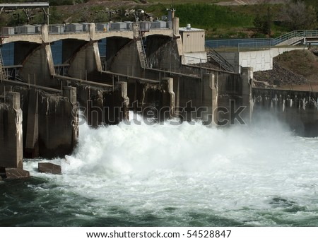 A torrent of water flows over Upriver Dam, Spokane, Washington