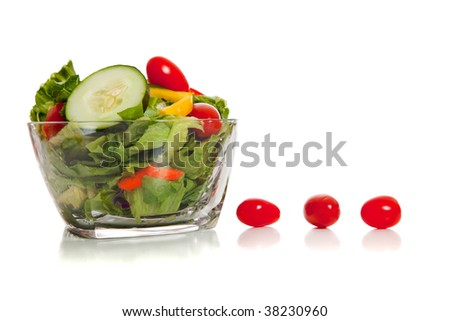 A tossed salad with various vegetables on a white background - stock photo