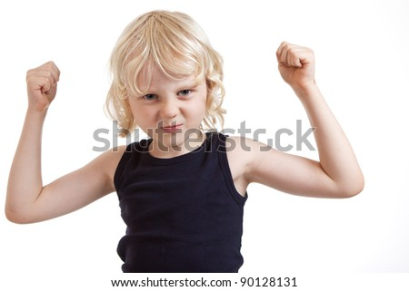 A tough cute boy boy flexing his muscles. Isolated over white.