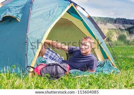 a tourist in a tent - stock photo