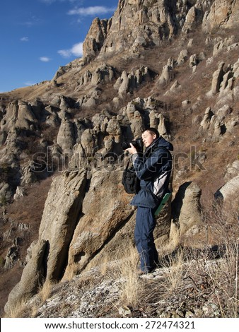A tourist snaps a photo of a natural wonder of the Australia - stock photo