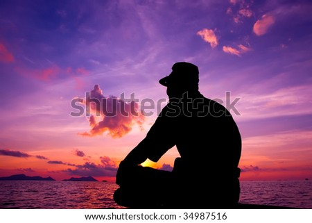 A tourist waits for the sunrise during travel to Malaysia Borneo Region of Sabah Mabul Semporna island - stock photo