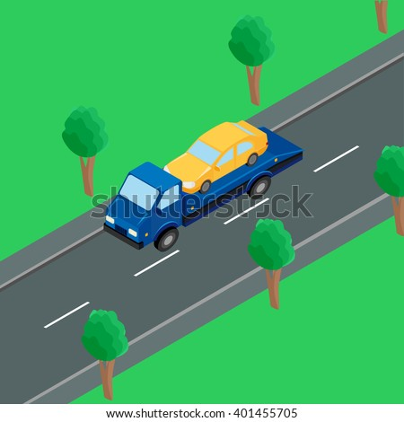 a tow truck carrying a car on the road - stock photo