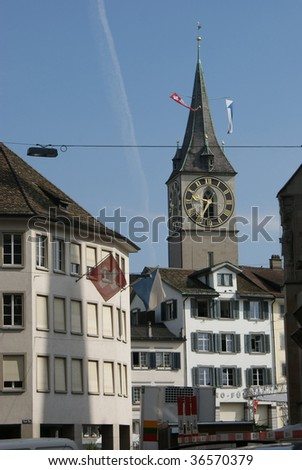 A tower clock is in town Zurich - stock photo