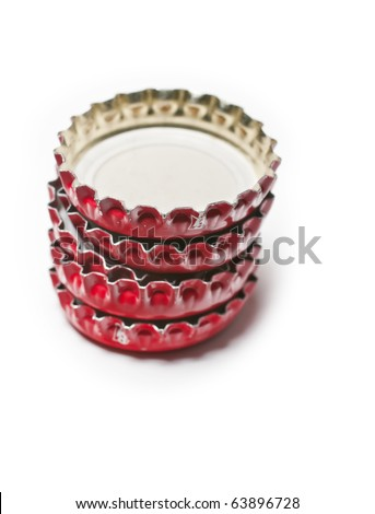 a tower of red crown caps on white background - stock photo