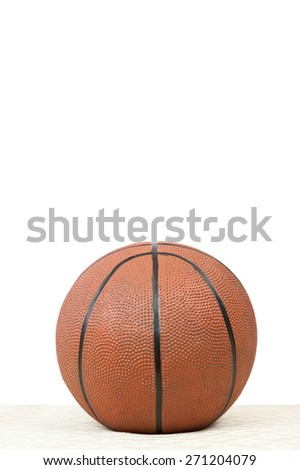A toy basketball on a white vertical background with space for text