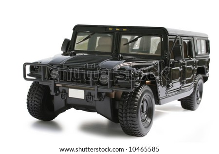 A toy black hummer jeep on a white background - stock photo