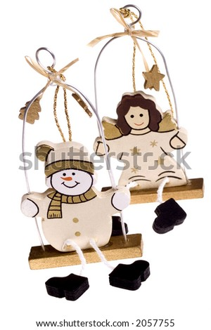 A toy figure of angel and snowman
