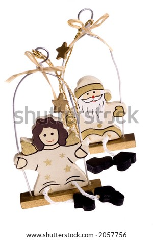 A toy figure of angel and snowman - stock photo