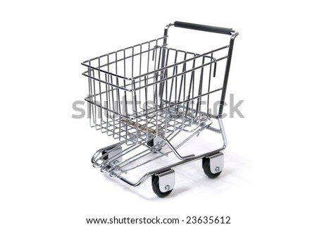 A Toy Sized Shopping Cart Against White Background - stock photo