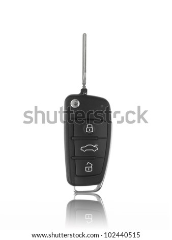A toy sports car key isolated against a white background - stock photo