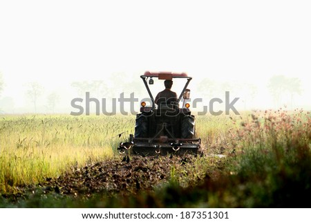 A tractor on field in Thailand - stock photo