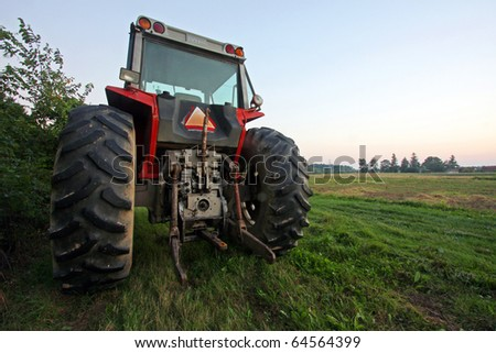 a tractor parked on grass - stock photo