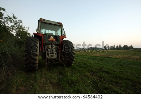 a tractor parked on grass