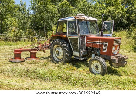 A tractor with mowers straw machine