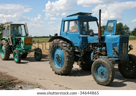 A tractors rides in the field on work