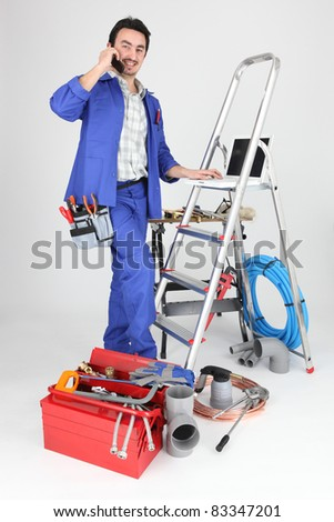 A tradesman with his tools and a stepladder - stock photo