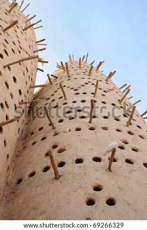 A traditional Arabian pigeon house, or dovecote, at the Katara traditional village in West Bay, Doha, Qatar, Arabia - stock photo