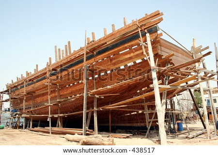 A traditional arabic dhow being constructed - stock photo