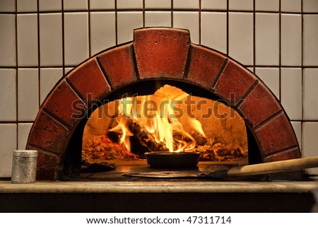 A traditional brick oven for cooking and baking. - stock photo
