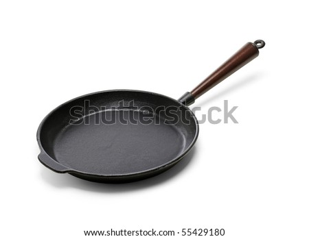 A Traditional cast iron frying pan isolated on white with natural shadows - stock photo