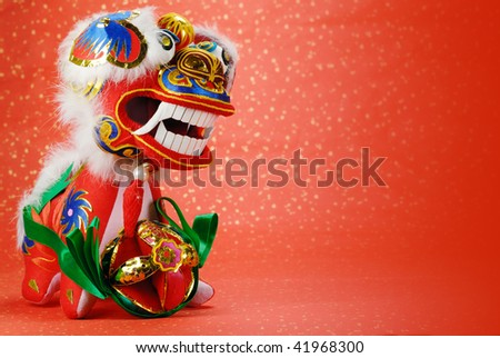 A traditional chinese dancing-lion on a festive background,the lion is believed to be able to dispel evil and bring good luck and prosperity in China. - stock photo