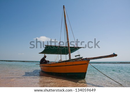 A traditional dhow floats in the lagoons of the Bazaruto Archipelago in Mozambique - stock photo