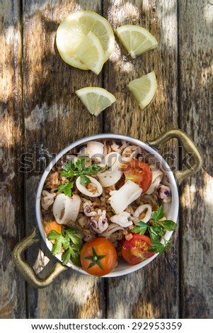 A traditional dish of Tuscany with farro and seafood - stock photo
