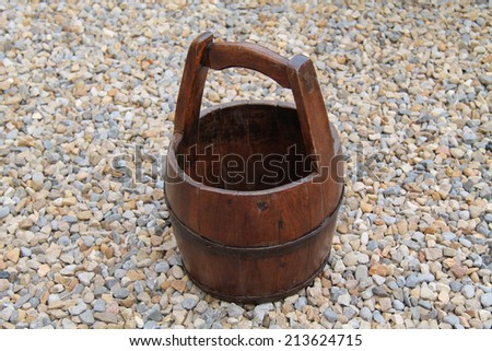 A Traditional Farming Wooden Milk Carrying Bucket. - stock photo