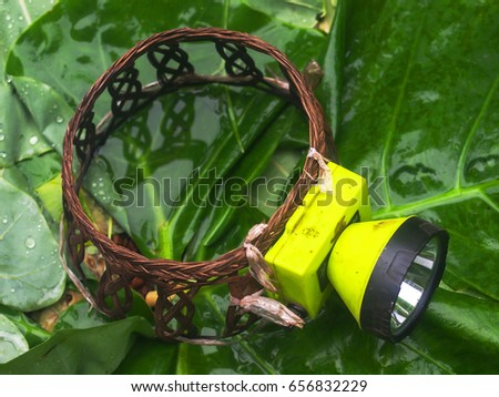 A traditional hand-made headband on an old headlight or torch used by Thai farmers, Thailand