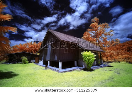 a traditional house in infrared - stock photo