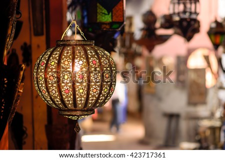 A traditional lamp on sale at a market stall in souks of Marrakech, Morocco. - stock photo