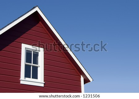 A traditional looking red house roof. - stock photo