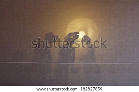 A Traditional Malaysian Shadow Puppet Show  - stock photo